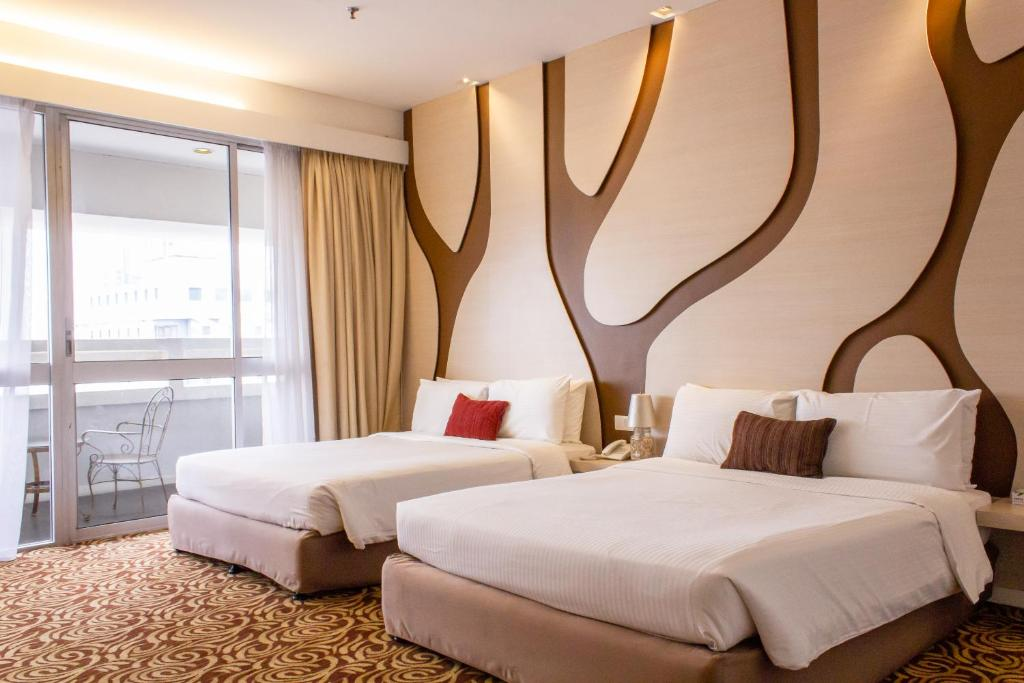 Ein Bett oder Betten in einem Zimmer der Unterkunft The 5 Elements Hotel Chinatown Kuala Lumpur