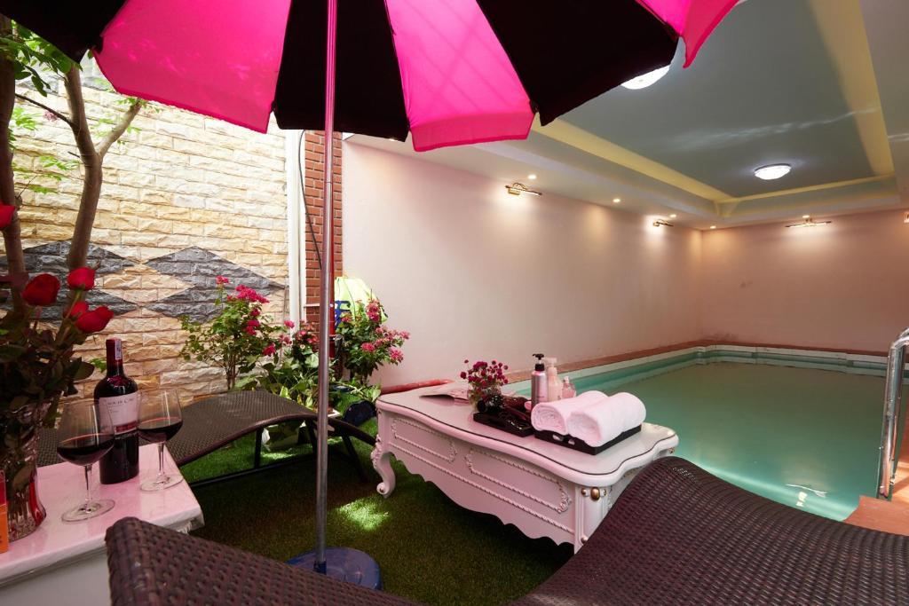 The swimming pool at or near Lucky Budda Inn Villa