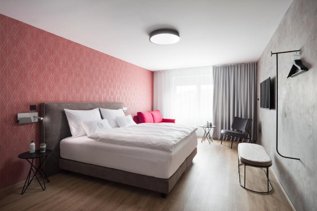 A bed or beds in a room at Central Hotel Superior