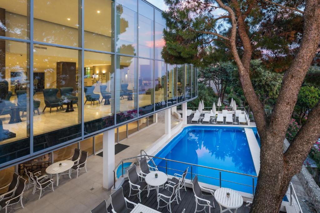 A view of the pool at Royal Ariston Hotel or nearby