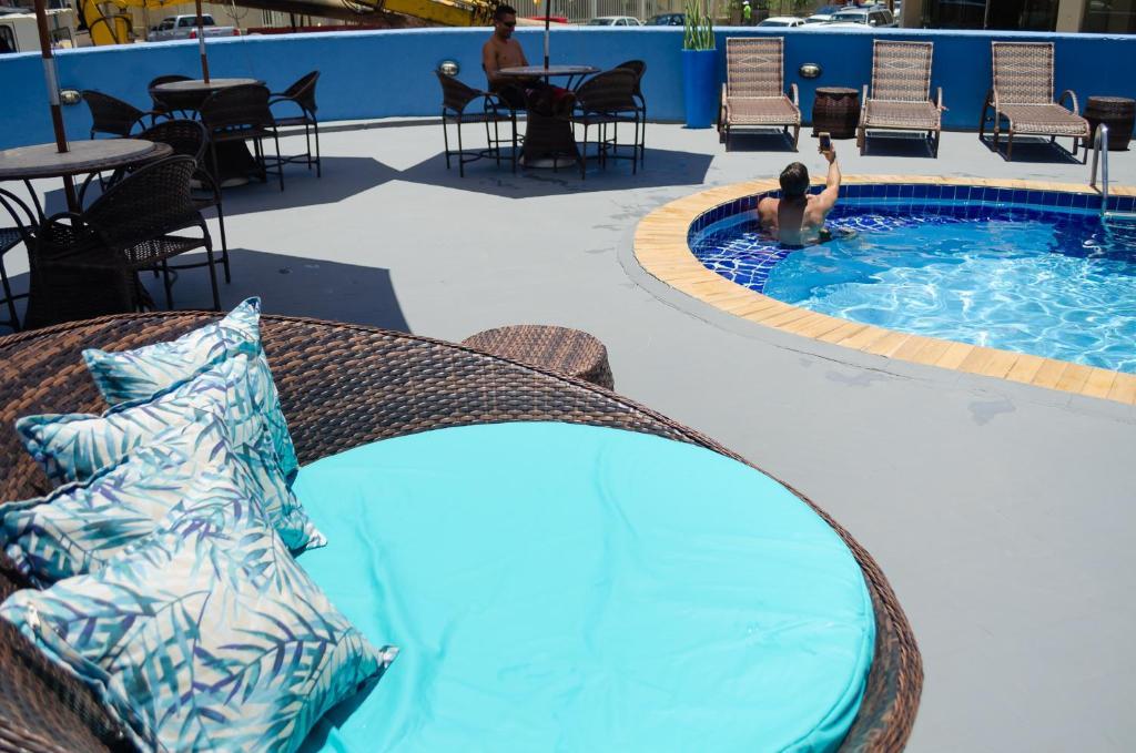 The swimming pool at or close to Bahia Sol e Mar