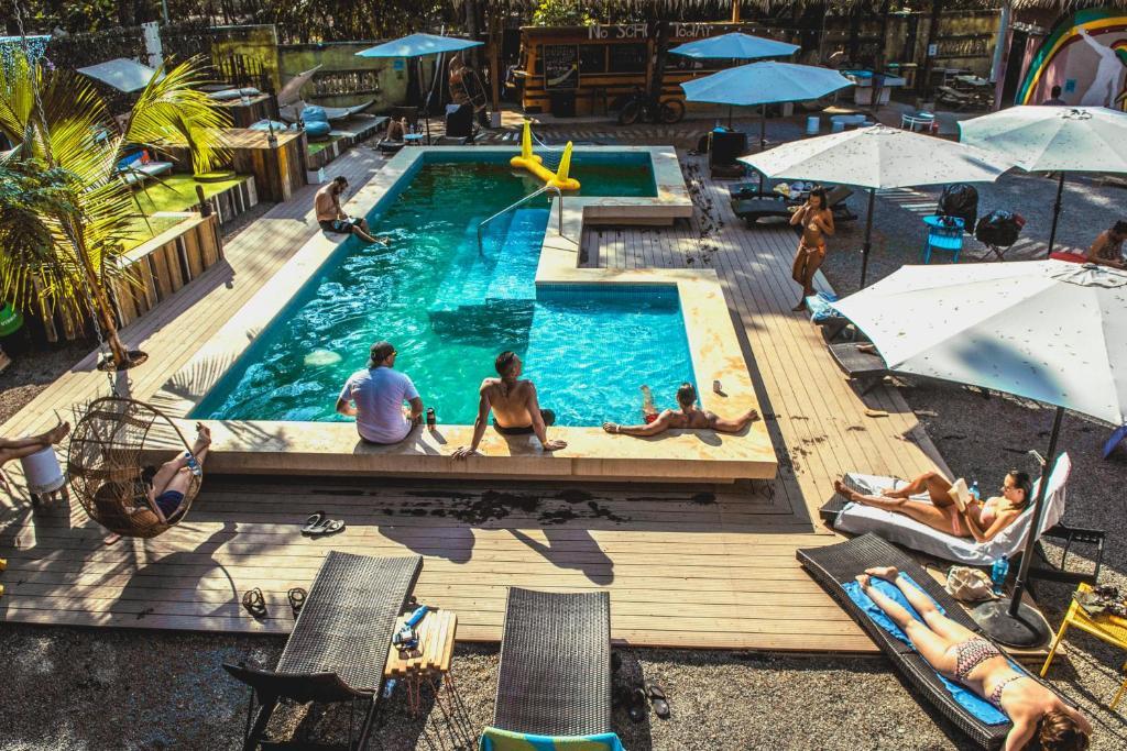 A view of the pool at Selina Santa Teresa North or nearby