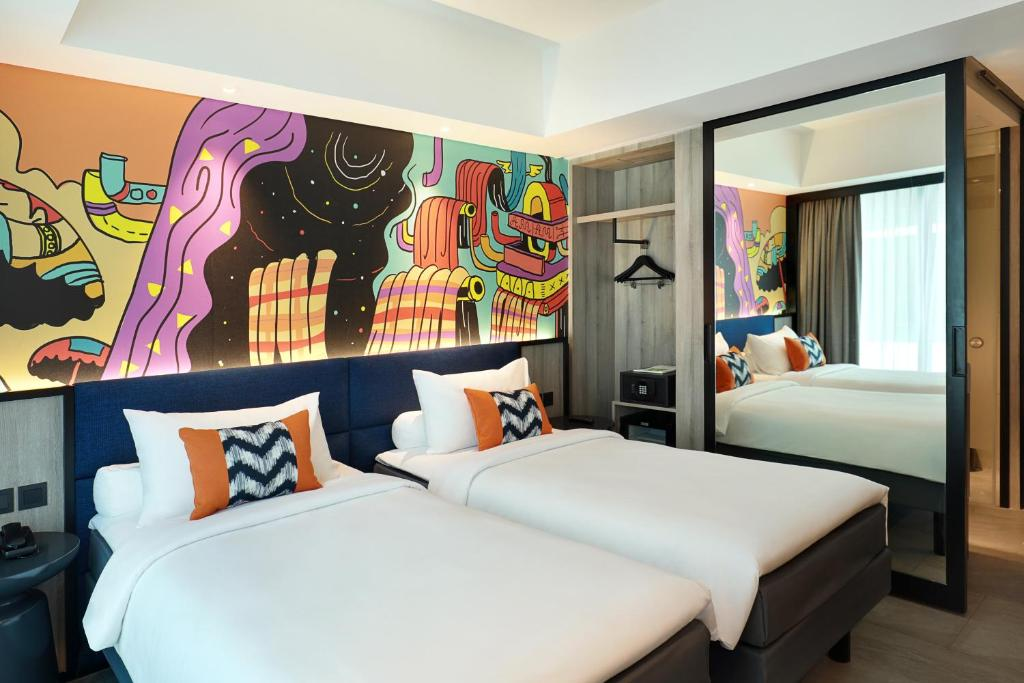 A bed or beds in a room at ibis Styles Jakarta Tanah Abang