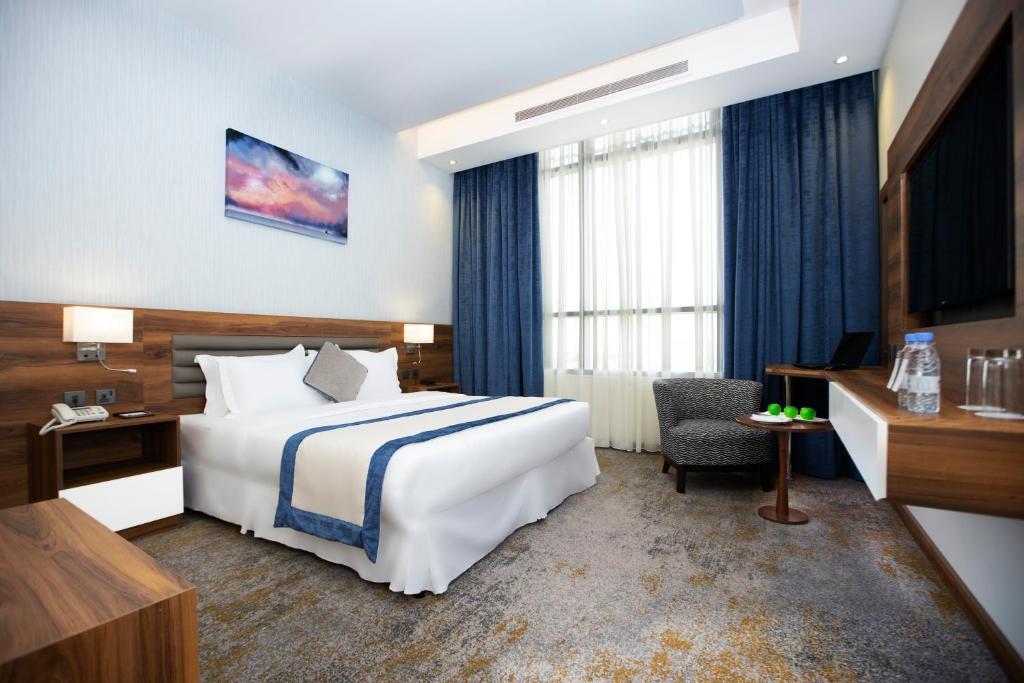 Cama ou camas em um quarto em EVA Hotel