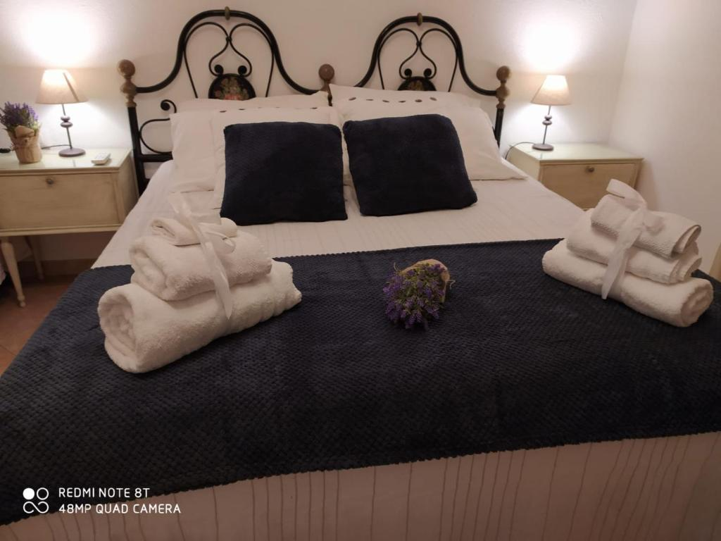 A bed or beds in a room at Borgo San Pietro