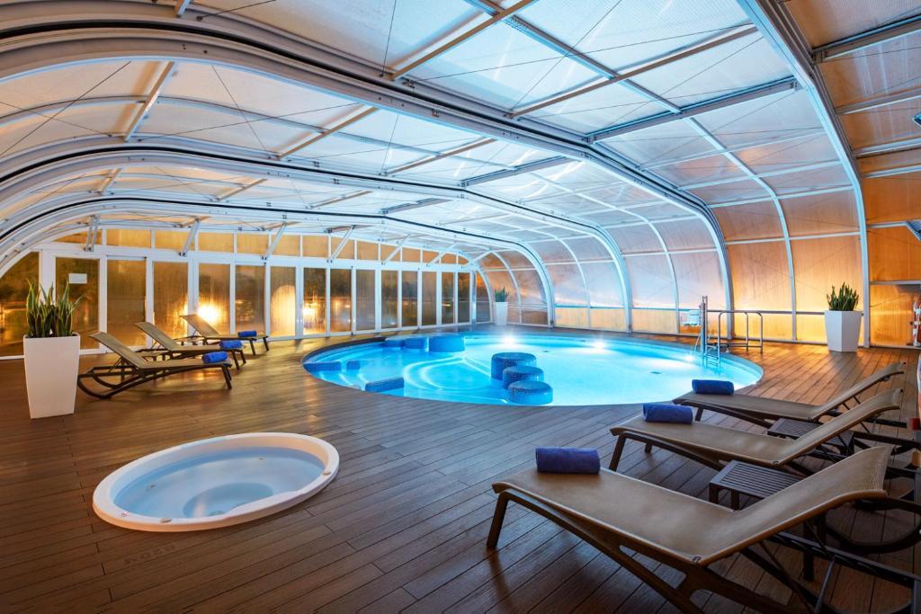 The swimming pool at or near Sercotel Sorolla Palace
