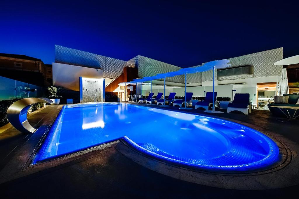 The swimming pool at or near Aleph Rome Hotel, Curio Collection By Hilton