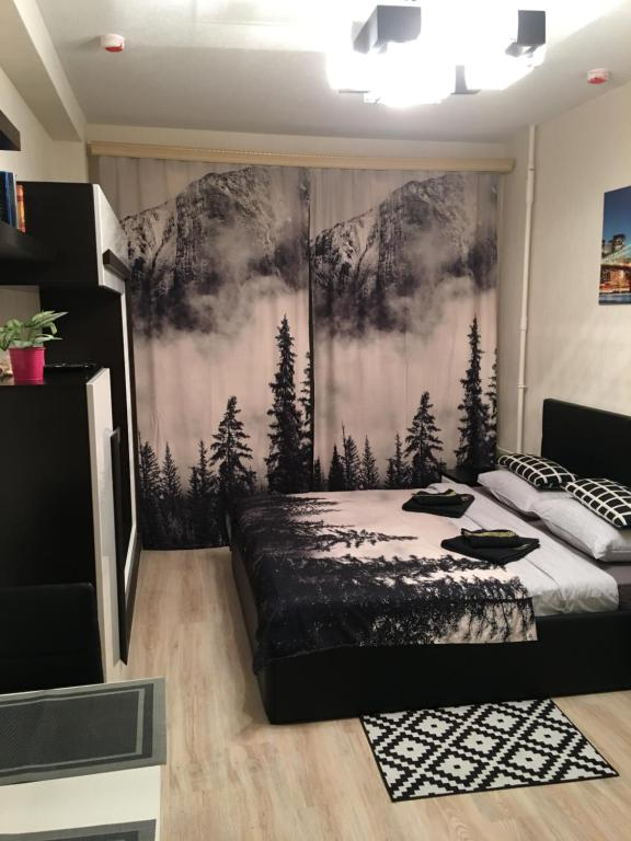 """Кровать или кровати в номере Апартаменты """"ДоМиНо"""""""