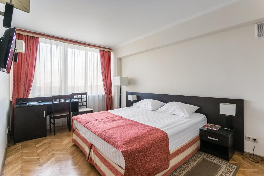 A bed or beds in a room at Universitetskaya Hotel