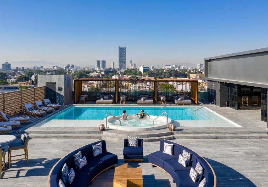 The swimming pool at or near Hilton Guadalajara Midtown
