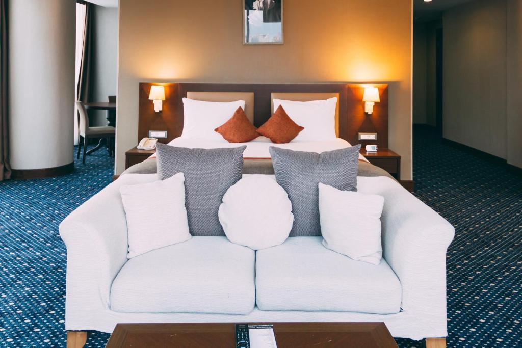 Cama ou camas em um quarto em Suite Apartments