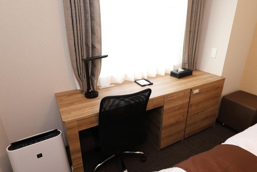 A television and/or entertainment centre at Smile Hotel Premium Osaka Higashishinsaibashi