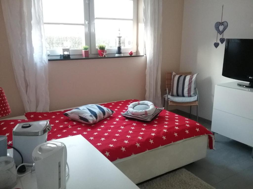A bed or beds in a room at Privatzimmer Essy in RE