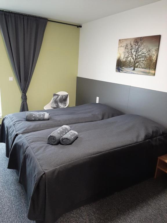 Ein Bett oder Betten in einem Zimmer der Unterkunft Office Base Bad Vöslau MOTEL