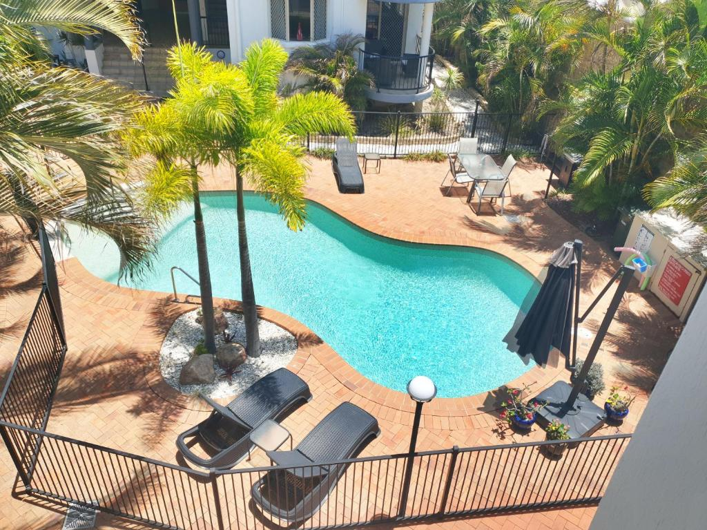 A view of the pool at Santalina On Hervey Bay or nearby