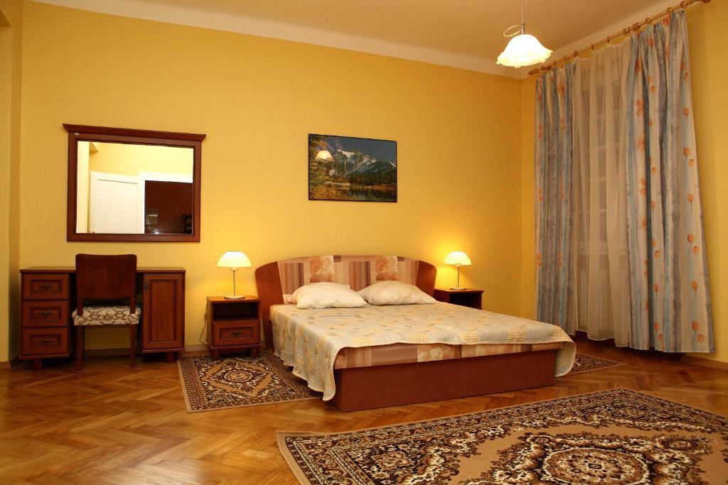 Postel nebo postele na pokoji v ubytování 7k - Apartmán Zámecký Vrch