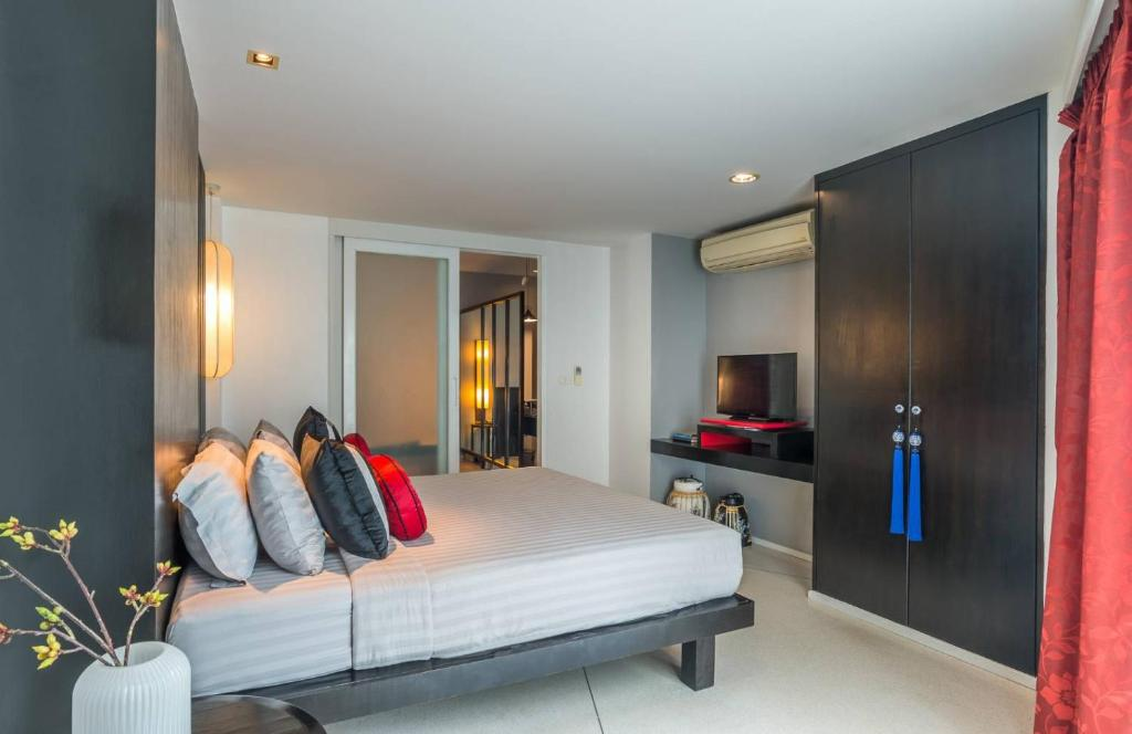 A bed or beds in a room at Red Ginger Chic Resort