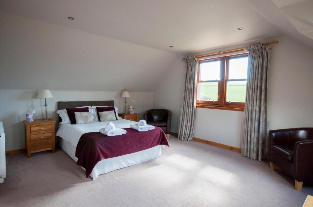 A bed or beds in a room at Chapel of Barras B&B