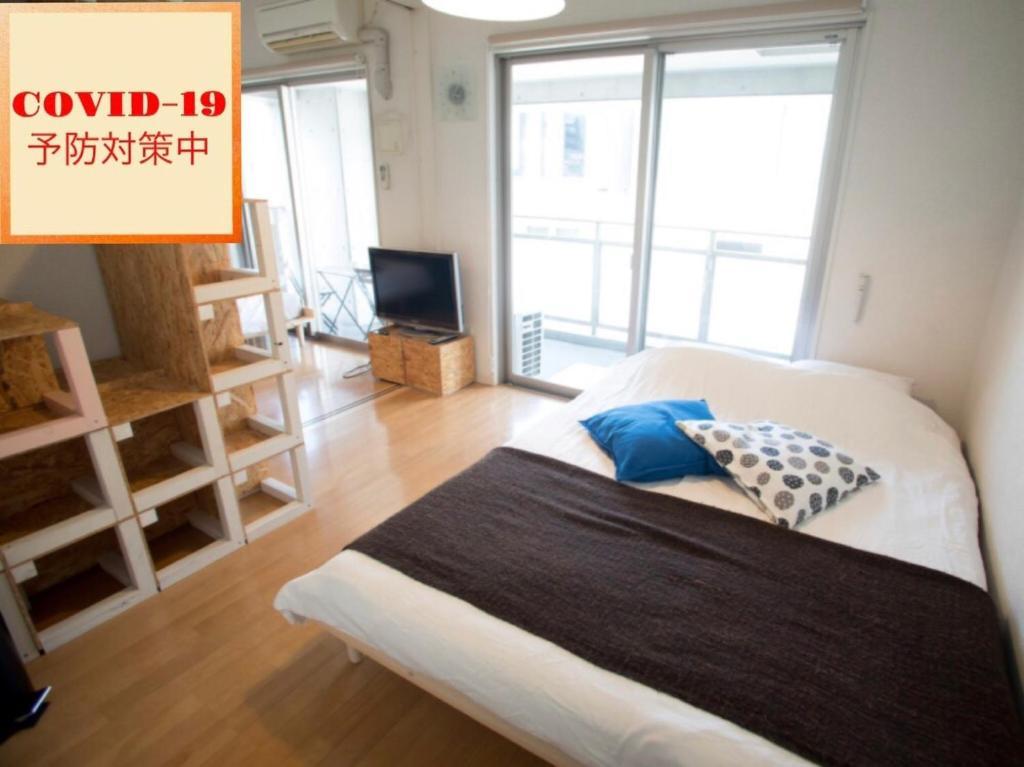Haruyoshi Cuffe Studio / Vacation STAY 7313にあるベッド