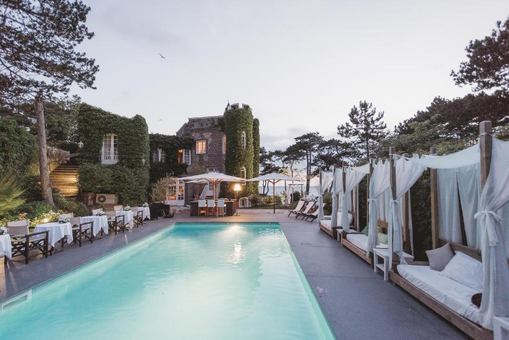 The swimming pool at or near Domaine Saint Clair - Le Donjon