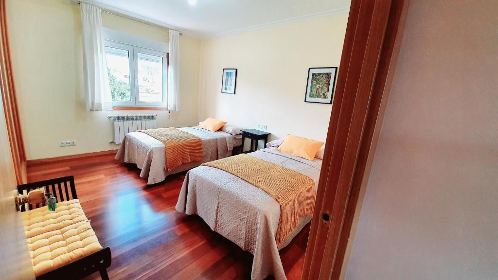 Łóżko lub łóżka w pokoju w obiekcie Estrella Do Camiño