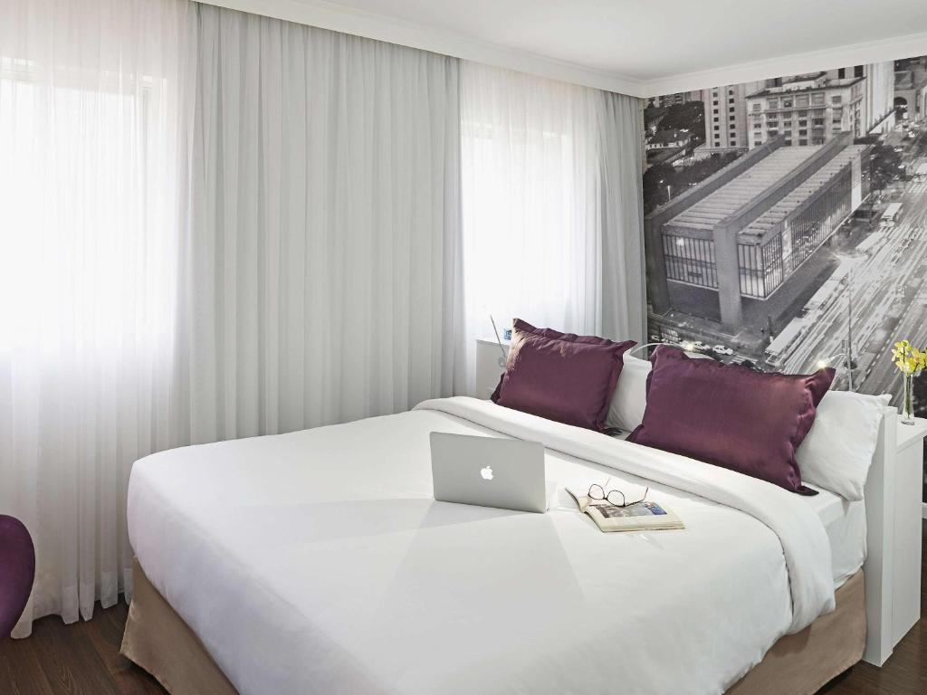 A bed or beds in a room at Mercure Sao Paulo Paulista
