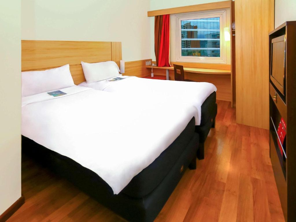 Cama ou camas em um quarto em ibis Santiago Providencia