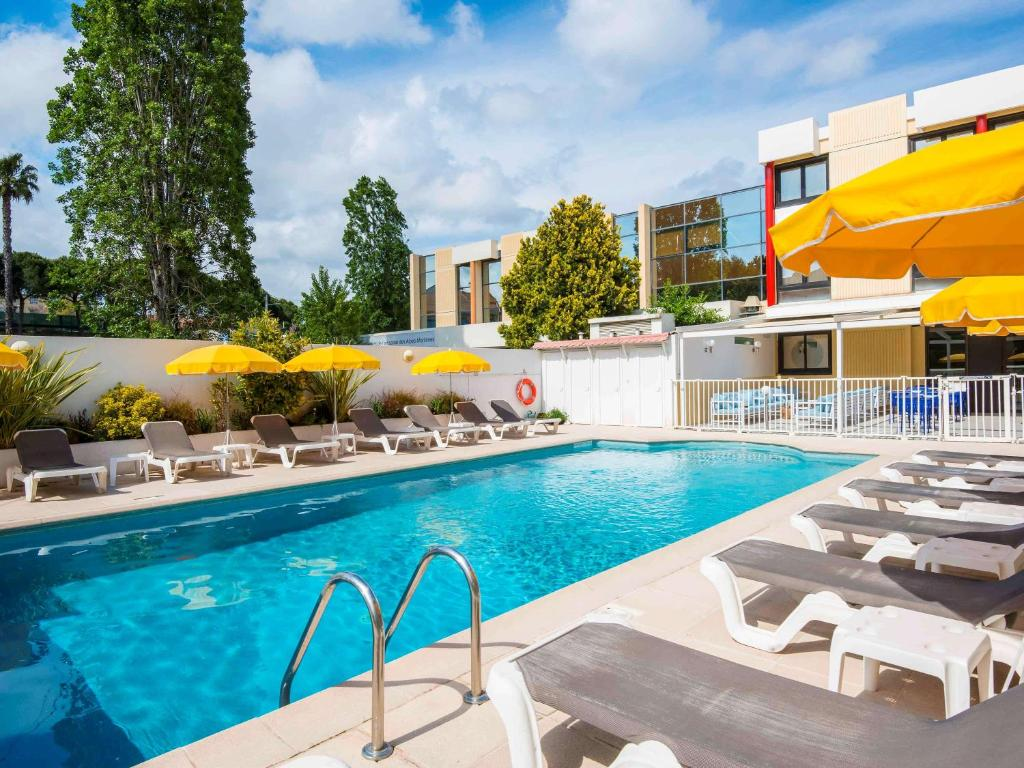 The swimming pool at or near ibis Styles Nice Cap 3000