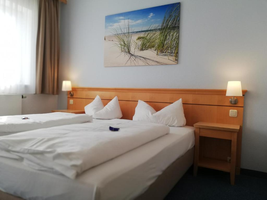 Ein Bett oder Betten in einem Zimmer der Unterkunft Hotel Nummerhof