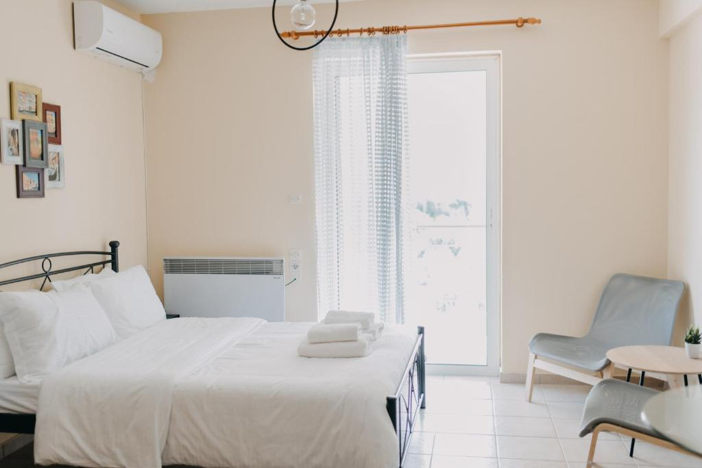 A bed or beds in a room at Best House, Nirvana II, Patra