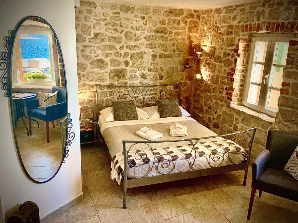 A bed or beds in a room at City Rooms Šibenik