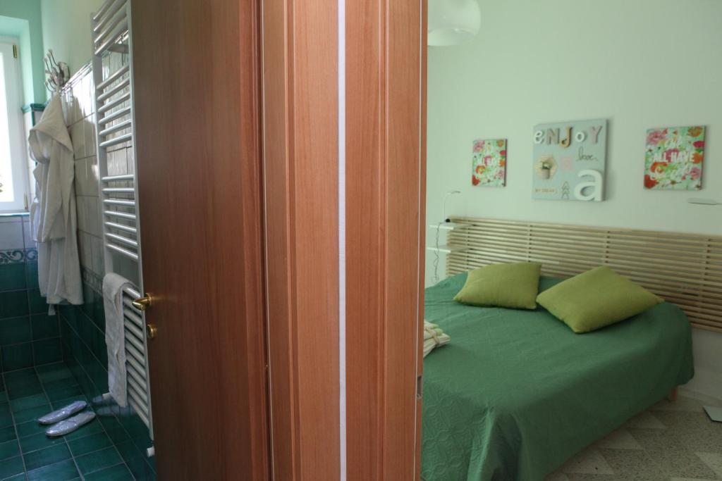 A bed or beds in a room at B&B Palazzo Scaramella
