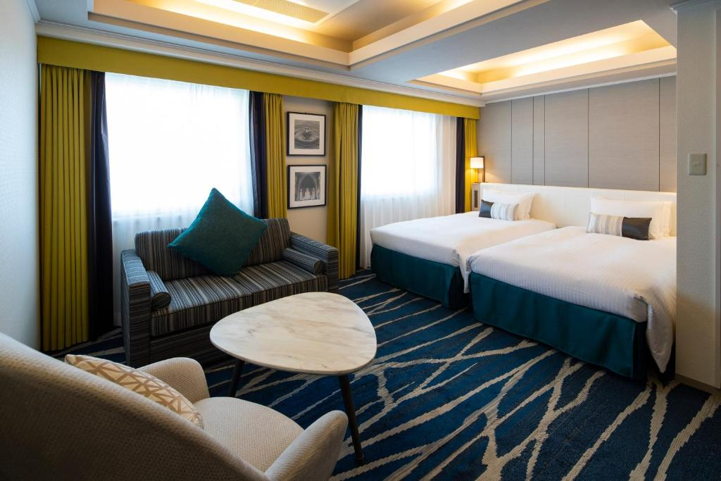 A bed or beds in a room at Shin Yokohama Grace Hotel