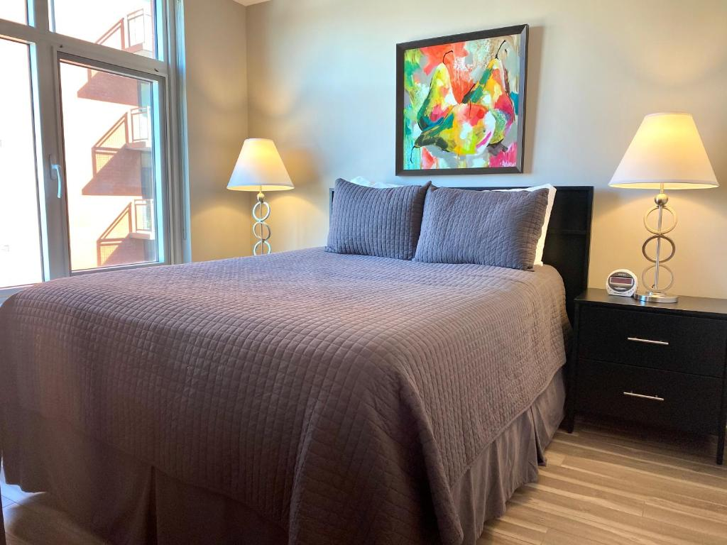 A bed or beds in a room at 5th Street NW Apartments