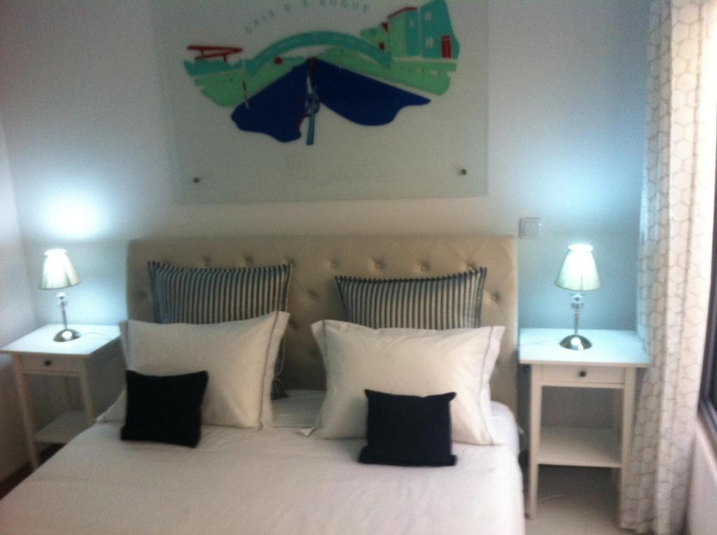 A bed or beds in a room at Casa do Cais