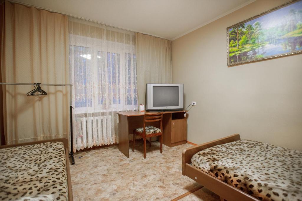 Телевизор и/или развлекательный центр в Гостиница квартирного типа Ленина 40