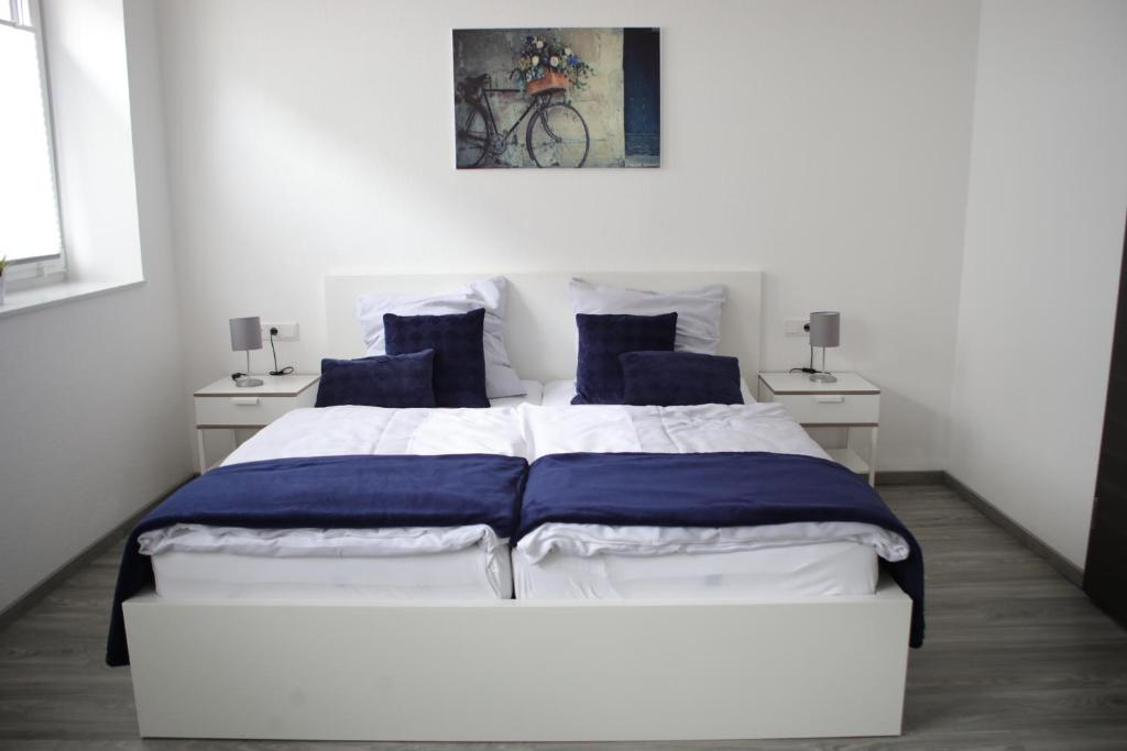 Ein Bett oder Betten in einem Zimmer der Unterkunft CityPension-Vreden
