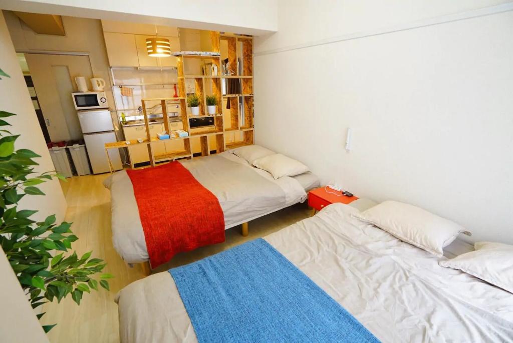 Daiichi Yoshizuru / Vacation STAY 7258にあるベッド