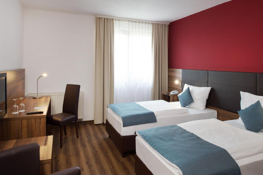 A bed or beds in a room at Michel Hotel Wetzlar