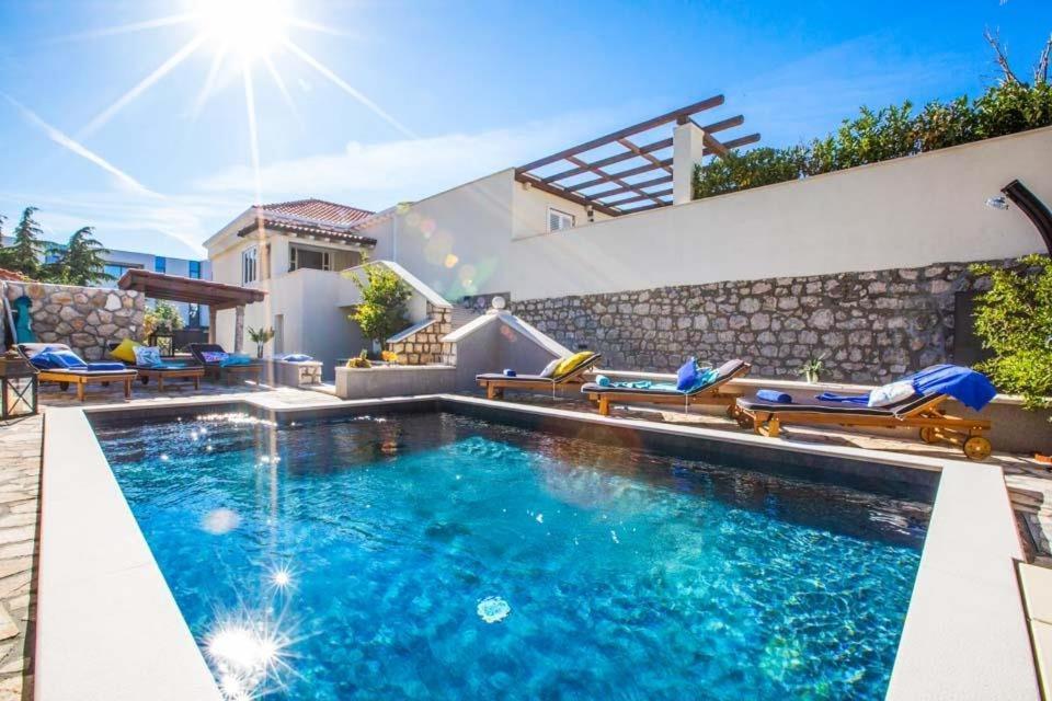 The swimming pool at or close to Srebreno Villa Sleeps 8 Pool Air Con WiFi
