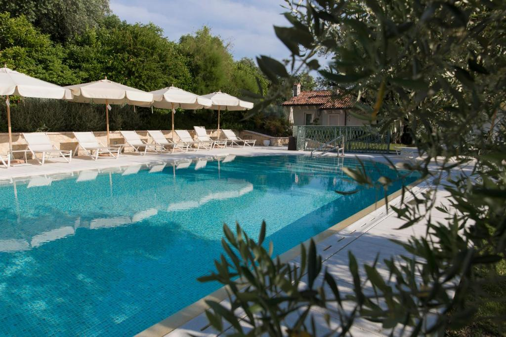 The swimming pool at or near Relais Fra' Lorenzo
