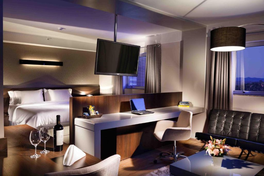A television and/or entertainment center at Delmond Hotel