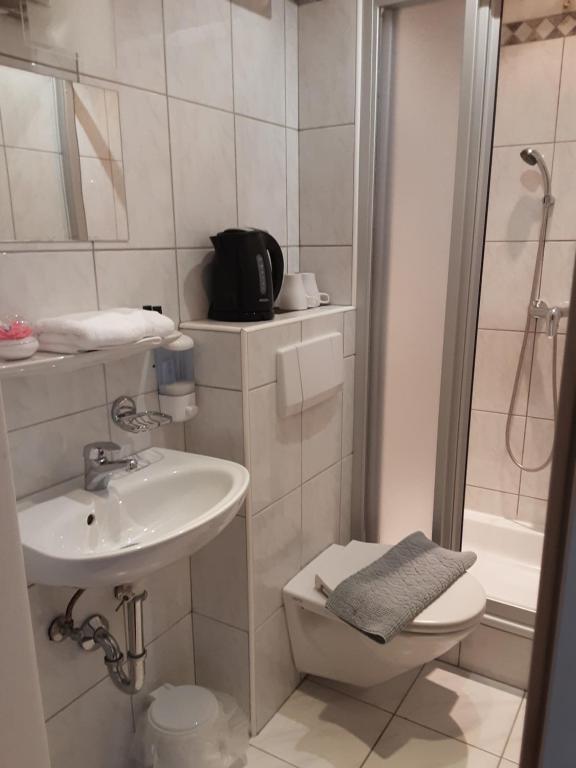A bathroom at Apartment House Seerose