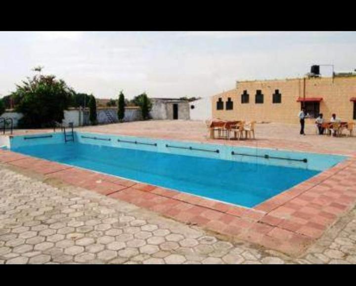The swimming pool at or near Vamoose Sambodhi