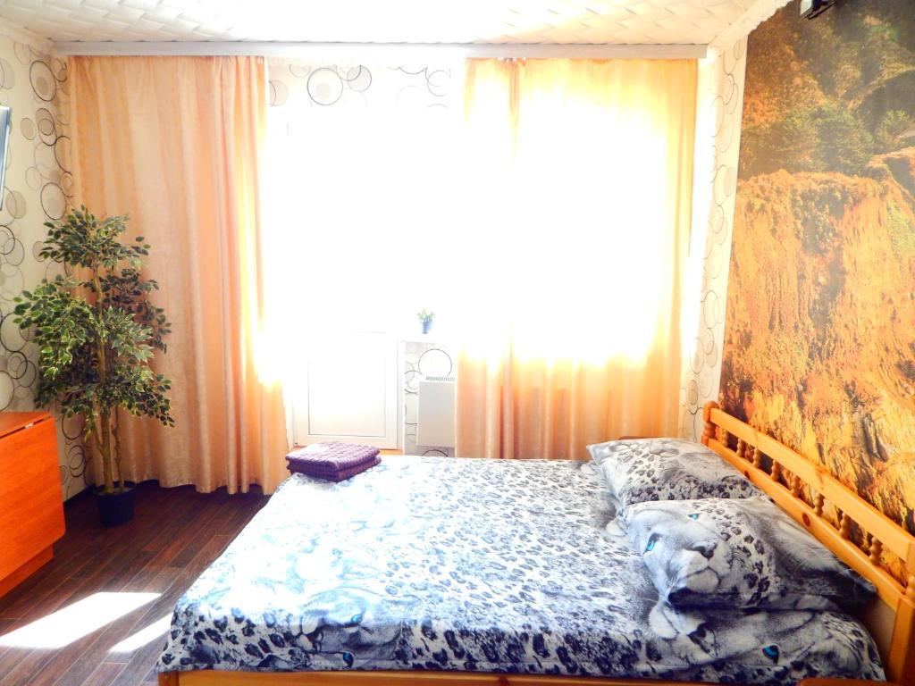 Кровать или кровати в номере Apartment-studio Sunset