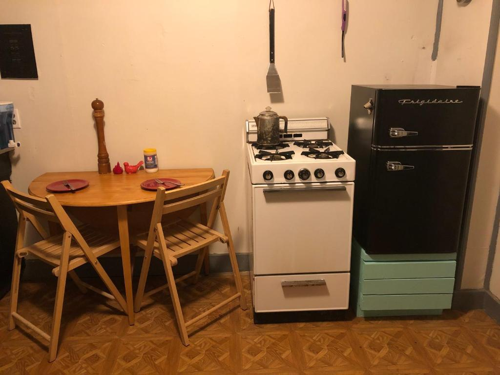 A kitchen or kitchenette at Lava Flow Hostel