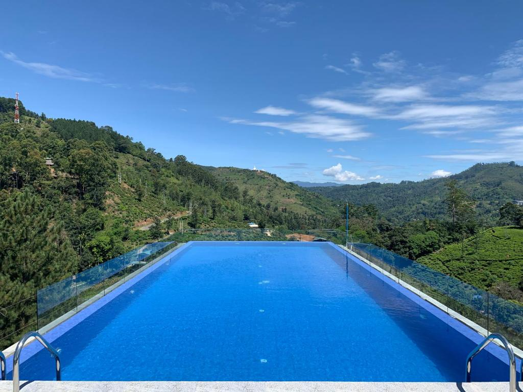 The swimming pool at or near Morning Dew Hotel