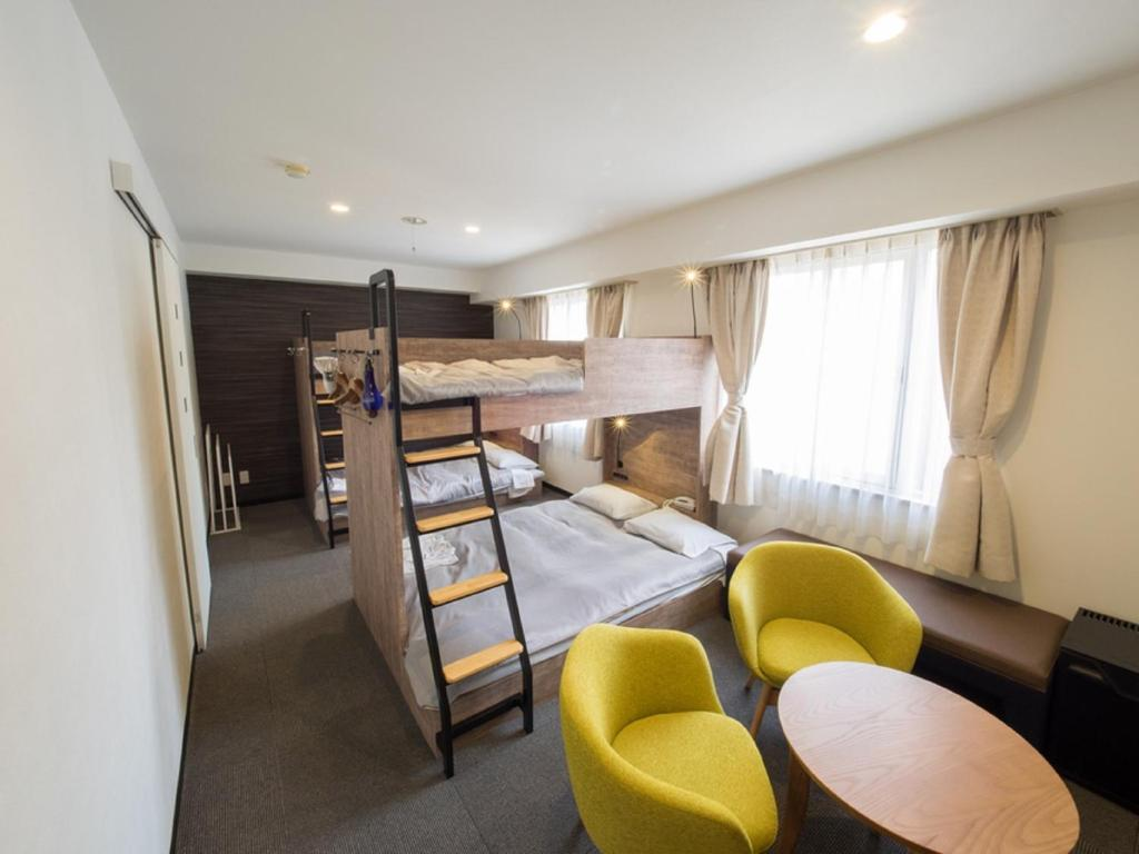 A bunk bed or bunk beds in a room at Hotel Shin Osaka / Vacation STAY 81530