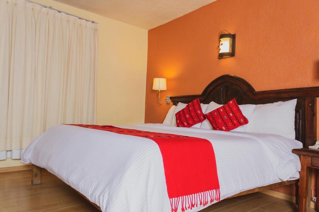 Кровать или кровати в номере Plaza Magnolias