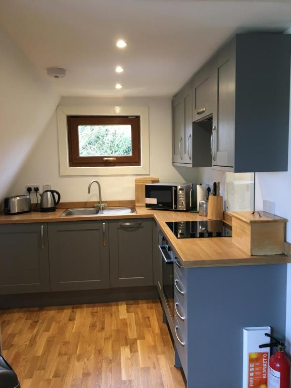 A kitchen or kitchenette at Craigs Lodges